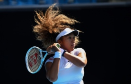 Japan's Naomi Osaka hits a return against France's Alize Cornet during their Gippsland Trophy women's singles tennis match in Melbourne on February 2, 2021. (Photo by William WEST / AFP) /