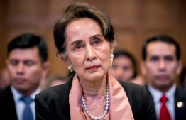"A handout photo released on December 10, 2019 by the International Court of Justice shows Myanmar's State Counsellor Aung San Suu Kyi attending the start of a three-day hearing on the Rohingya genocide case before the UN International Court of Justice at the Peace Palace of The Hague. - Nobel peace laureate Aung San Suu Kyi faced calls for Myanmar to ""stop the genocide"" of Rohingya Muslims as she personally led her country's defence at the UN's top court on December 10. (Photo by Frank Van BEEK / UN Photo/ICJ / AFP) /"