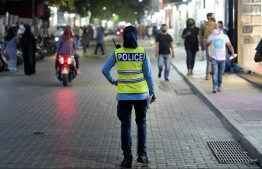 A police officer on the streets of Male' during curfew hours. PHOTO: NISHAN ALI / MIHAARU