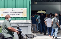 (FILE) Photo taken outside Hulhumale' Vaccination Center on February 14, 2021: government aims to vaccinate 90 percent of the eligible population by the end of August  -- Photo: Nisham Ali/ Mihaaru