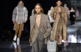 (FILES) In this file photo taken on February 17, 2020 models present creations during the British fashion house Burberry 2020 Autumn / Winter collection catwalk show during London Fashion Week in London. - London Fashion Week, which begins on February 19, 2021, has shifted to a virtual format amid Britain's Covid lockdown and while usual mainstays like Victoria Beckham won't be parcitipating, designers like Burberry have embraced the online show. (Photo by Ben STANSALL / AFP)