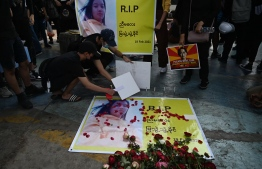 Protesters hold a vigil for Mya Thwate Thwate Khaing, a demonstrator who died from a gunshot wound during a rally against the military coup earlier in the month, in Yangon on February 20, 2021. (Photo by YE AUNG THU / AFP)