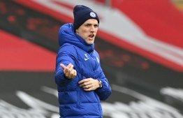 Chelsea's German head coach Thomas Tuchel gestures from the side-lines during the English Premier League football match between Southampton and Chelsea at St Mary's Stadium in Southampton, southern England on February 20, 2021. (Photo by NEIL HALL / POOL / AFP) / RESTRICTED TO EDITORIAL USE. No use with unauthorized audio, video, data, fixture lists, club/league logos or 'live' services. Online in-match use limited to 120 images. An additional 40 images may be used in extra time. No video emulation. Social media in-match use limited to 120 images. An additional 40 images may be used in extra time. No use in betting publications, games or single club/league/player publications. /