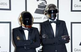 "(FILES) In this file photo taken on January 26, 2014 recording artists Guy-Manuel de Homem-Christo (L) and Thomas Bangalter of Daft Punk attend the 56th Grammy Awards at Staples Center in Los Angeles, California. - French electronic music stars Daft Punk have split up, their publicist confirmed on February 22, 2021, ending one of the era's defining dancefloor acts. The duo released a video titled ""Epilogue"" in which one of the robot duo is blown up in the desert, followed by a cutaway reading ""1993-2021"". (Photo by Jason Merritt / GETTY IMAGES NORTH AMERICA / AFP)"