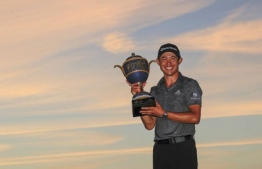 Collin Morikawa with his winning trophy. (Sam Greenwood/Getty images via AFP)