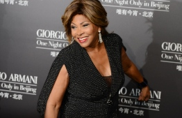 "(FILES) This file photo taken on May 31, 2012 shows US singer Tina Turner arriving on the red carpet for a fashion show in Beijing. - Music legend Tina Turner is the subject of one of the most successful biopics ever made but she tells the makers of a new documentary there's much more to her story. ""Tina"" by Oscar-winning directors Dan Lindsay and T.J. Martin premiered on March 2, 2021 at the Berlin film festival. (Photo by MARK RALSTON / AFP)"
