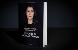 "This photograph taken on March 1, 2021 in Paris shows the book ""Rescapee du Goulag Chinois"" (Survivor of the Chinese Gulag), written by Gulbahar Haitiwaji, a French resident of Uighur origin who was imprisoned and sent to a re-education camp, co-authored with Le Figaro journalist Rozenn Morgat and published by Editions des Equateurs."
