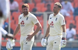England's captain Joe Root (R)and his teammate Jonny Bairstow take a drink break during the first day of the fourth Test cricket match between India and England at the Narendra Modi Stadium in Motera on March 4, 2021. (Photo by Sajjad HUSSAIN / AFP) /