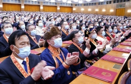 A grand gathering is held to mark the nation's poverty alleviation accomplishments and honor model poverty fighters at the Great Hall of the People in Beijing, capital of China, Feb. 25, 2021