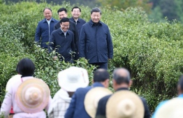 Chinese President Xi Jinping inspects poverty alleviation work in a tea farm of Laoxian township, Pingli county of Ankang, Northwest China's Shaanxi Province, on April 21, 2020.