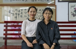 Ms. Zhang Guimei with Chen Fayu, a 2012 graduate from the Huaping Girls' High School, on July 4, 2020. Chen is a police officer now.