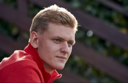 (FILES) In this file photo taken on September 30, 2020 This photo taken on september 29, 2020 and handout by Ferrari on September 30, 2020 shows German racing driver Mick Schumacher at the Ferrari Driver Academy (FDA) in Maranello, Italy. - The son of seven-time world champion Michael Schumacher moved a step closer to a spot on the 2021 Formula One circuit when Alfa Romeo announced it would again test the 21-year-old. (Photo by Handout / FERRARI PRESS OFFICE / AFP) /