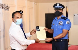 Minister of Home Affairs handing over the letter of appointment to the new DCP Ali Rasheed. PHOTO: TWITTER, CP HAMEED