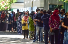 People waiting to get vaccinated at one of the vaccination centres in Male'. PHOTO: NISHAN ALI / MIHAARU