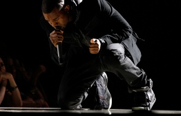 (FILES) In this file photo musician Kanye West performs onstage during the 50th annual Grammy awards held at the Staples Center on February 10, 2008 in Los Angeles, California. - A pair of Nike Air Yeezy 1s worn by rapper Kanye West sold for $1.8 million, triple the previous record for sneakers, Sotheby's said on April 26, 2021.The shoes beat the record held by a pair of Nike Air Jordan 1s which sold for $615,000 in August 2020 at a Christie's auction. (Photo by Kevin Winter / GETTY IMAGES NORTH AMERICA / AFP)