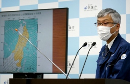Japan Meteorological Agency's director of earthquake and tsunami observation division Shinya Tsukada speaks during a press conference in Tokyo on May 1, 2021 after a 6.8-magnitude earthquake struck off country's northeastern coast. (Photo by STR / JIJI PRESS / AFP) /
