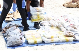 (FILE) Photo provided by the Police carrying large amounts of drugs they had collected on various occasion -- There was 955g of drugs in the box with the bridal dress -- Photo: Police