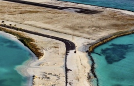The runway of Hoarafushi Airport covered in sand after surge waves on May 14 -- Photo: Mihaaru file