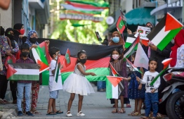 Children with Palestinian flags, showing solidarity to Palestine -- Photo: Nishan Ali/ Mihaaru