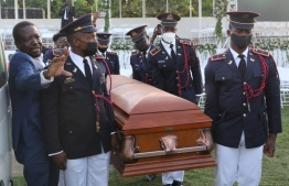 Soldiers of the Armed Forces of Haiti guard carry the casket of slain President Jovenel Moïse before his funeral on July 23, 2021, in Cap-Haitien, Haiti. Moïse, 53, was shot dead in his home in the early hours of July 7 -- Photo: Valerie Baeriswyl/ AFP