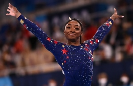 USA's Simone Biles reacts after competing in the artistic gymnastics balance beam event of the women's qualification during the Tokyo 2020 Olympic Games at the Ariake Gymnastics Centre in Tokyo on July 25, 2021. -- Photo:  Loic Venance/ AFP