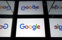 (FILES) In this file photo illustration taken on February 17, 2019, the Google logo displayed on a tablet in Paris. - Russia has fined Google over $40,000 for violating Russian law that states Russian citizen's data must be stored in Russia -- Photo: Lionel Bonaventure/ AFP