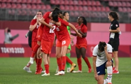 USA's forward Carli Lloyd (R) reacts to the loss in the Tokyo 2020 Olympic Games women's semi-final football match between the United States and Canada at Ibaraki Kashima Stadium in Kashima on August 2, 2021 -- Photo: Kazuhiro Nogi/ AFP