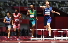 Norway's Karsten Warholm (R) crosses the finish line to win and break the world record in the men's 400m hurdles final during the Tokyo 2020 Olympic Games at the Olympic Stadium in Tokyo on August 3, 2021 -- Photo: Jewel Samad/ AFP