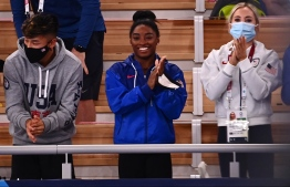USA's Simone Biles (C) applauds during  the artistic gymnastics women's floor exercise final during the Tokyo 2020 Olympic Games at the Ariake Gymnastics Centre in Tokyo on August 2, 2021 -- Photo: Loic Venance/ AFP