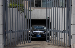 A car with diplomatic plates leaves the Polish embassy in Tokyo on August 3, 2021, where Belarus athlete Krystsina Tsimanouskaya is believed to be sheltering after she claimed her team tried to force her to leave Japan following a row during the Tokyo 2020 Olympic Games, a day after she was granted a humanitarian visa to Poland -- Photo:  Yuki Iwamura/ AFP