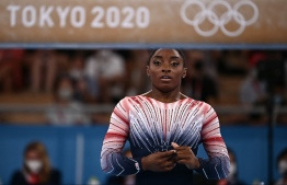 USA's Simone Biles gets ready to compete in the artistic gymnastics women's balance beam final of the Tokyo 2020 Olympic Games at Ariake Gymnastics Centre in Tokyo on August 3, 2021 -- Photo: Lionel Bonaventure/ AFP