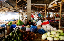 A vegetable seller arranges his produce at a market in Lhokseumawe, Aceh on August 5, 2021, as Indonesia's economy bounced back by in the second quarter of the year, the first positive growth in five quarters since the pandemic hit the archipelagic nation and the largest expansion since 2010 -- Photo: Azwar Ipank/ AFP
