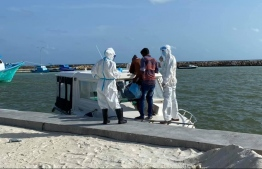 (FILE) Photo taken on August 15 showing a person being transferred from Raa Dhuvaafaru to the COVID Management Facility in Baa Eydhafushi: Dhuvaafaru has been under monitoring since May 25 -- Photo: Dhuvaafaru Health Center