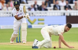 India's KL Rahul (L) plays a shot as England's Mark Wood (R) fields on the first day of the second cricket Test match  between England and India at Lord's cricket ground in London on August 12, 2021 -- Photo:  Glyn Kirk / AFP
