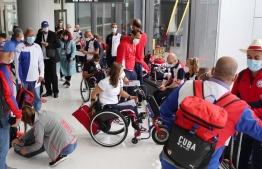 Teams from France and Cuba participating in the Tokyo 2020 Paralympics arrive at Narita Airport in Narita, Chiba Prefecture on August 17, 2021 -- Photo: STR / JIJI PRESS / AFP