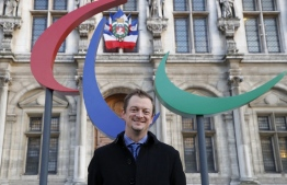 """(FILES) This file photo taken on November 10, 2017 shows President of the International Paralympic Committee (IPC) Andrew Parsons of Brazil posing outside the City Hall of Paris. - Having no fans at the Tokyo Paralympics will be """"a challenge"""", IPC chief Andrew Parsons said on August 18, 2021, but he is confident the event will reach """"more people than ever before"""" -- Photo: Francois Guillot/ AFP"""