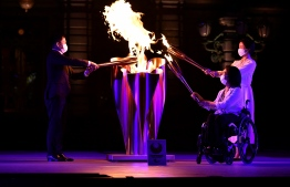 Tokyo 2020 Torch Relay Official Ambassadors Tadahiro Nomura (L), Aki Taguchi (2nd R), Satomi Ishihara (R) take part in the Paralympic Flame Lighting Ceremony at the State Guest House Akasaka Palace in Tokyo on August 20, 2021 -- Photo: Kazuhiro Nogi/ AFP