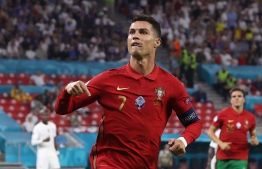 (FILES) In this file photo taken on June 23, 2021 Portugal's forward Cristiano Ronaldo celebrates after scoring a second penalty kick during the UEFA EURO 2020 Group F football match between Portugal and France at Puskas Arena in Budapest on June 23, 2021. - Manchester United announced on Friday they have reached a deal to re-sign Cristiano Ronaldo from Juventus, 12 years after he left Old Trafford for Real Madrid.-- Photo: Bernadett Szabo/ Pool/ AFP