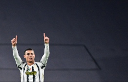 (FILES) In this file photo taken on November 24, 2020 Juventus' Portuguese forward Cristiano Ronaldo celebrates after scoring an equalizer during the UEFA Champions League Group G football match Juventus vs Ferencvaros on November 24, 2020 at the Juventus stadium in Turin. - Cristiano Ronaldo has decided he no longer wants to play for Juventus, coach Massimiliano Allegri revealed on August 27, 2021, as rumours of an imminent move to Manchester City gather pace. -- Photo: Miguel Medina/ AFP