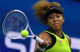 Japan's Naomi Osaka hits a return to Czech Republic's Marie Bouzkova during their 2021 US Open Tennis tournament women's singles first round match at the USTA Billie Jean King National Tennis Center in New York, on August 30, 2021 -- Photo: Ed Jones/ AFP