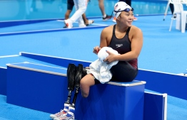 Haven Shepherd of the US dries off after competing in the women's 100m breaststroke SB7 swimming heat during the Tokyo 2020 Paralympic Games at the Tokyo Aquatics Centre in Tokyo on September 1, 2021. -- Photo: Behrouz Mehri/ AFP