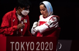Afghanistan's Zakia Khudadadi prepares to compete with Uzbekistan's Ziyodakhon Isakova in their women's taekwondo K44 bout during the Tokyo 2020 Paralympic Games at Makuhari Messe Hall in Chiba on September 2, 2021 -- Photo: Philip Fong/ AFP