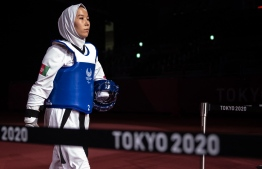 Afghanistan's Zakia Khudadadi prepares to compete in the women's taekwondo K44 -49kg repechage quarter-final against Ukraine's Viktoriia Marchuk during the Tokyo 2020 Paralympic Games at Makuhari Messe Hall in Chiba on September 2, 2021. -- Photo: Philip Fong/ AFP