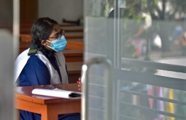 A student attends her class at the Rajuk Uttara Model College in Dhaka on September 12, 2021, as Bangladesh schools reopened after 18 months in one of the world's longest shutdowns due to the Covid-19 coronavirus pandemic. (Photo by Munir Uz zaman / AFP)
