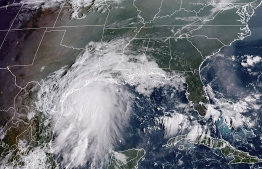 This RAMMB National Oceanic and Atmospheric Administration (NOAA) satellite handout image shows Tropical Storm Nicholas, off the coastline of the US state of Texas at 13H40 UTC on September 13, 2021. -- Photo by Handout / RAMMB/NOAA/NESDIS / AFP