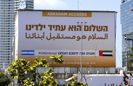 A billboard by the United Arab Emirates Embassy marking the signing of the US-brokered Abraham Accords are seen along the expressway in the Israeli coastal city of Tel Aviv on September 14, 2021. -- Photo: Jack Guez/ AFP
