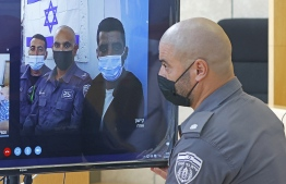 Palestinian militant Zakaria Zubeidi (screen-3rd-L) attends via Zoom a court session in the Israeli city of Nazareth on September 19, 2021. - Zubeidi, one of the six Palestinian militants who escaped from a high-security prison, was recaptured on September 11. All six Palestinian fugitives who escaped a high-security Israeli jail through a tunnel dug under a sink are back in custody, after the Israeli army said it had recaptured the last two. --  Photo Jack Guez/ AFP
