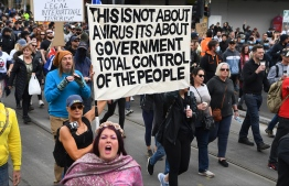 Protesters march through the streets during an anti-lockdown rally in Melbourne on September 18, 2021.  -- Photo: William West/ AFP