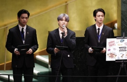 (L-R) Taehyung/V, Suga and Jin of South Korean boy band BTS take turns speaking at the SDG Moment event as part of the UN General Assembly 76th session General Debate at United Nations Headquarters, on September 20, 2021 in New York. -- Photo: John Angelillo / Pool / AFP