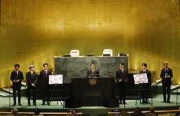 (L-R) Taehyung/V, Suga, Jin, RM, Jungkook, Jimin and JHope of South Korean boy band BTS speak at the SDG Moment event as part of the UN General Assembly 76th session General Debate at United Nations Headquarters, on September 20, 2021 in New York --  Photo: John Angelillo / Pool / AFP